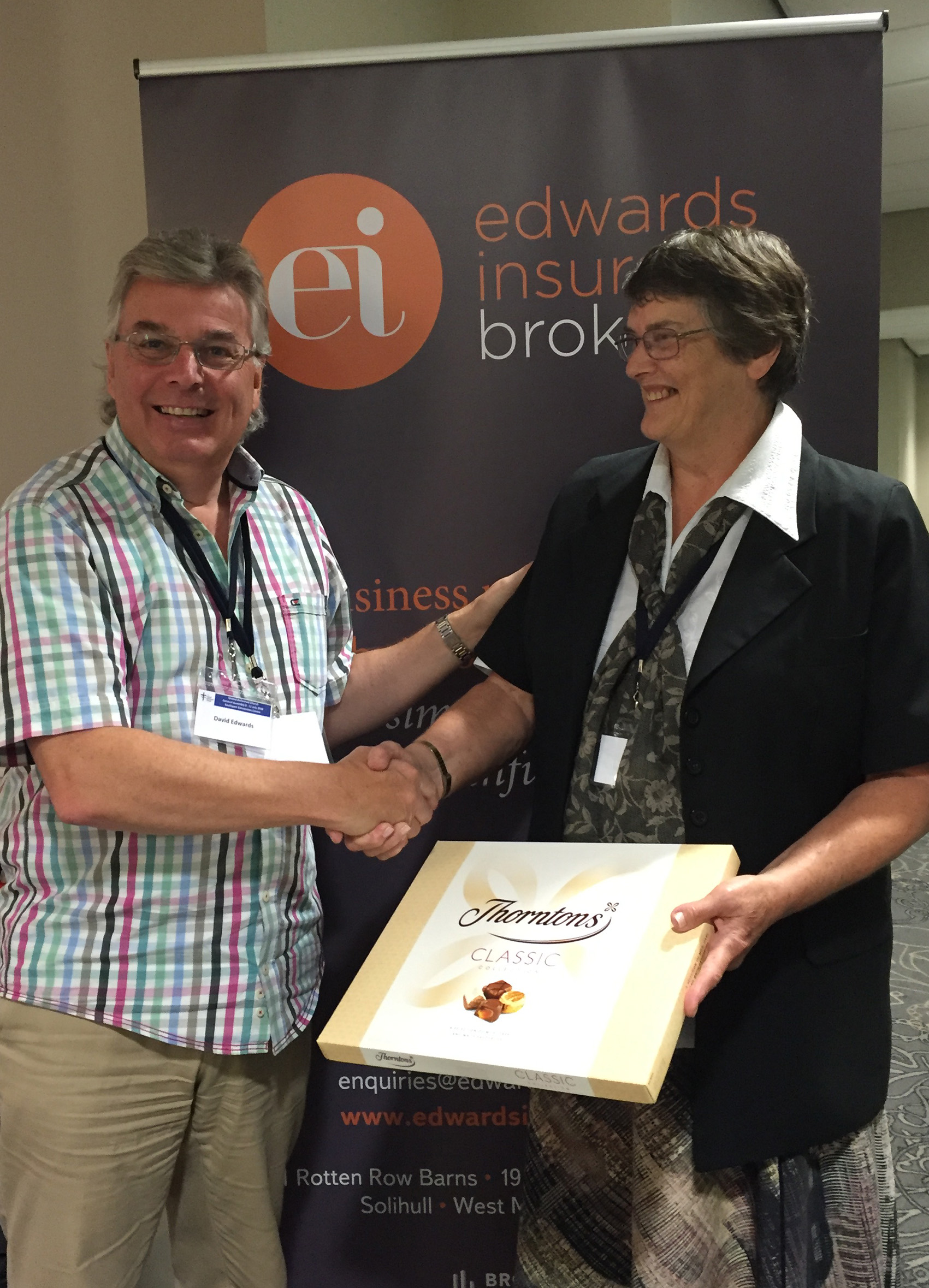 competition winner Rev. Ann Woodhurst receives chocolate prize at URC General Assembly
