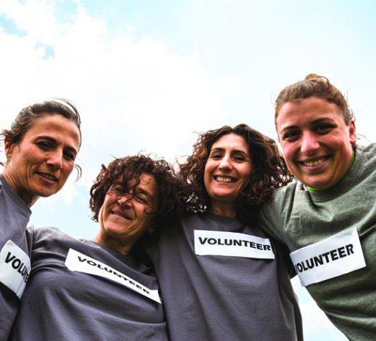 smiling volunteers