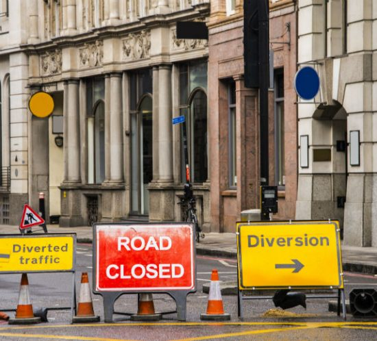 road closed with yellow diversion signs