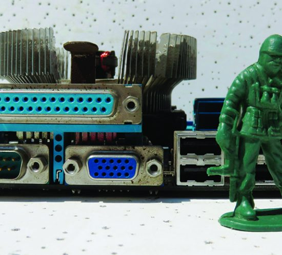 green toy soldier with computer connectors